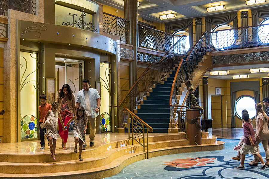 The three-deck atrium lobby on the Disney Wonder features Art Nouveau-inspired details reminiscent of the Golden Age of cruising. A bronze statue of Ariel from the classic Disney film ìThe Little Mermaidî is a focal point and a favorite photo location for guests. (Matt Stroshane, photographer)