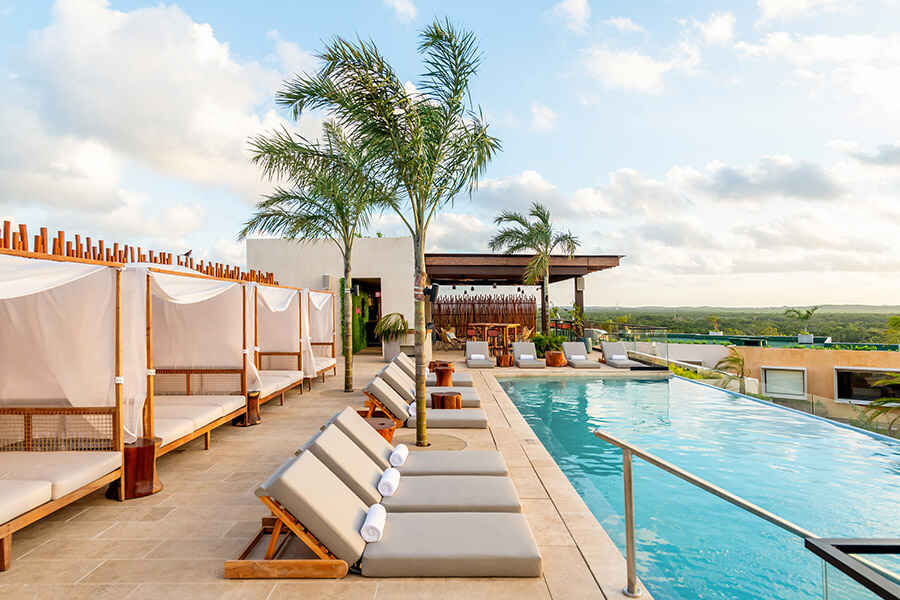 Infinity pool at Atico Rooftop Lounge & Bar, which overlooks the Mayan ruins, stunning beaches and the city